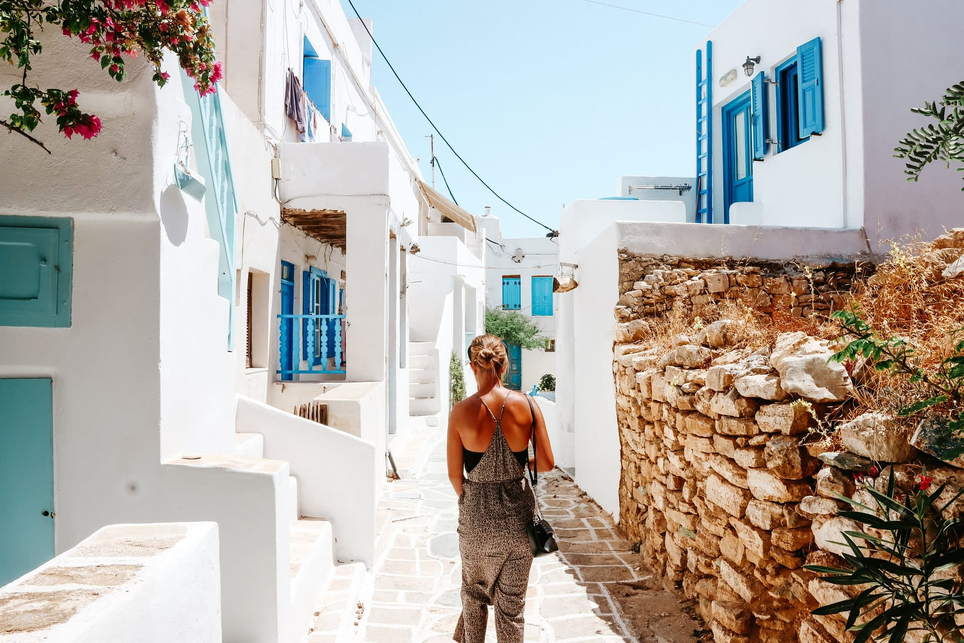 A woman walking down the streets of Folegandros castro
