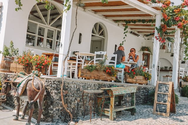 A couple eating at a taverna in Pygros village