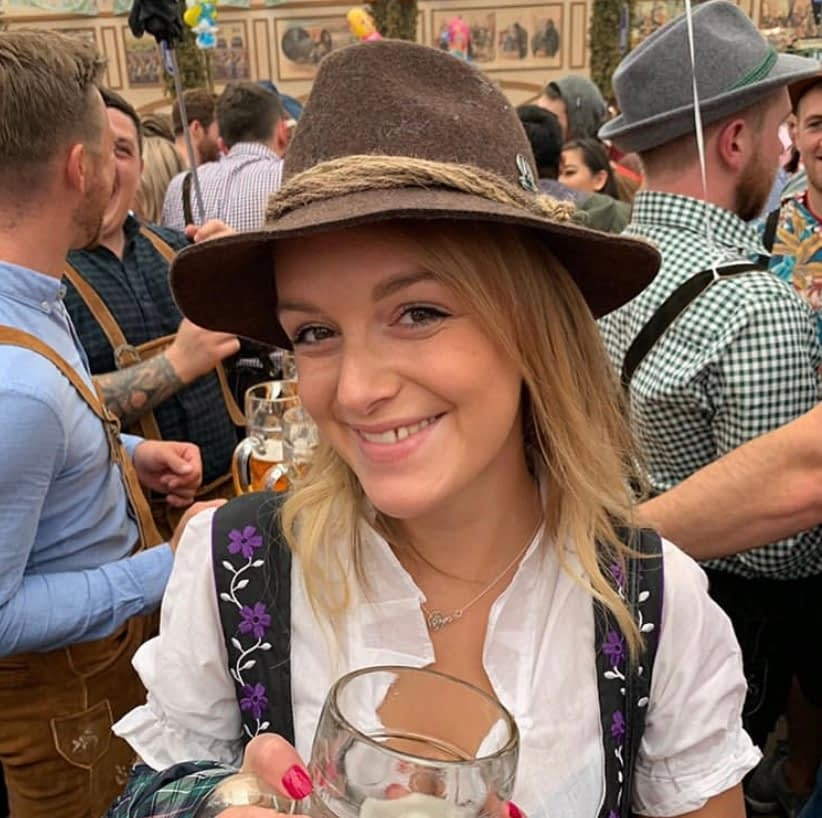 A woman with a bavarian hat - what to do at oktoberfest