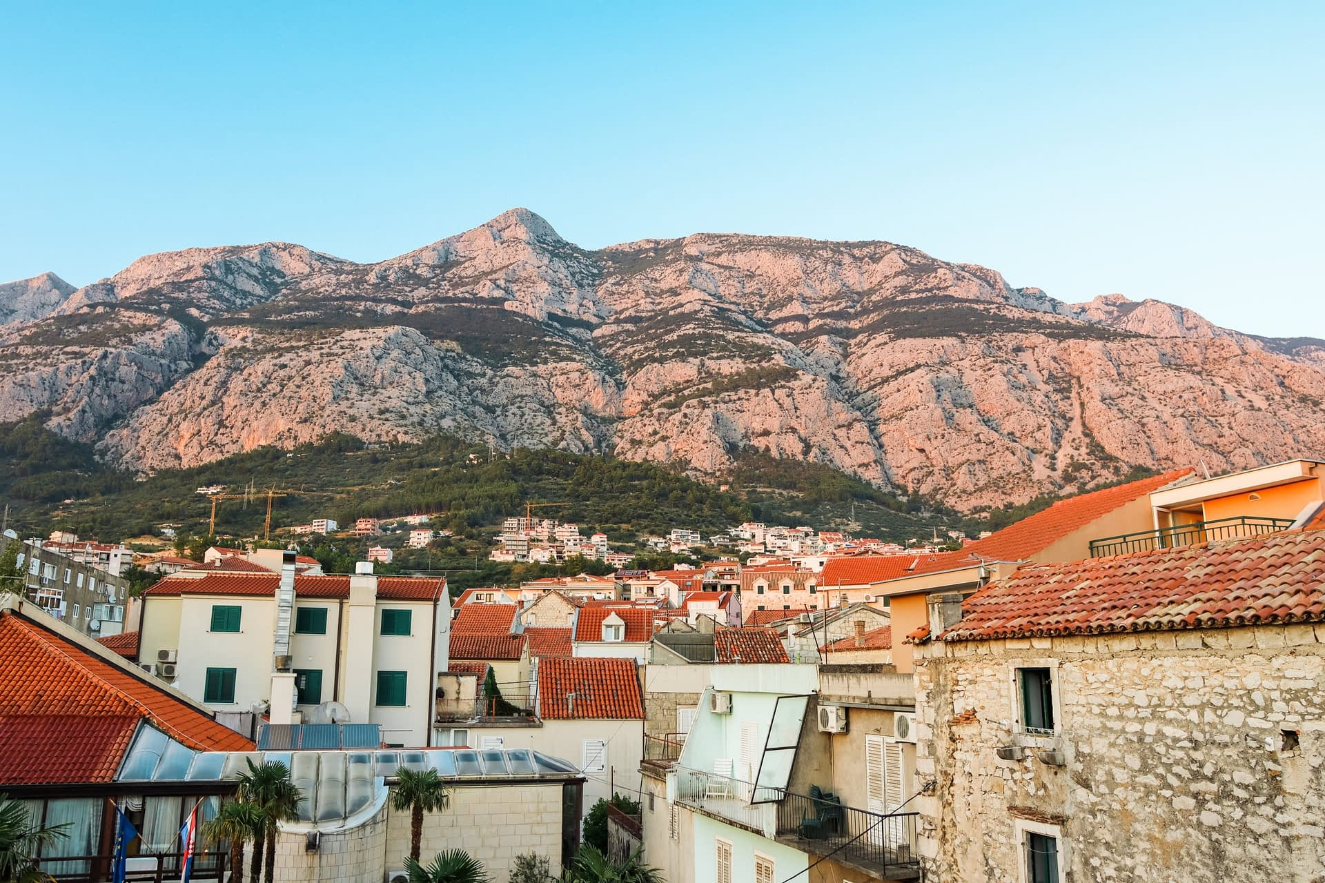 Mountains during sunset with Makarksa old town in the background. Things to see in Makarska