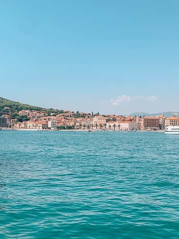 Buildings and the ocean in Split. How to get to Hvar