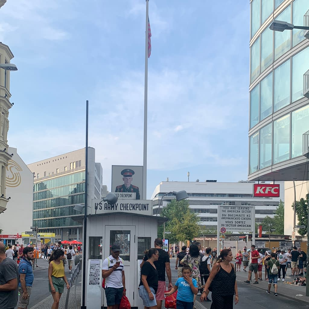 Checkpoint Charlie crowded with lots of people. Advised to go as part of the Berlin city break guide.
