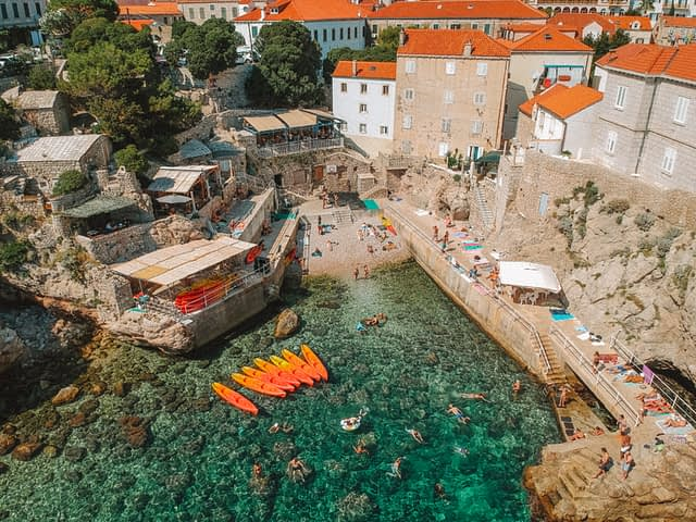 Šulići beach aerial picture with turquoise sea and orange kayaks