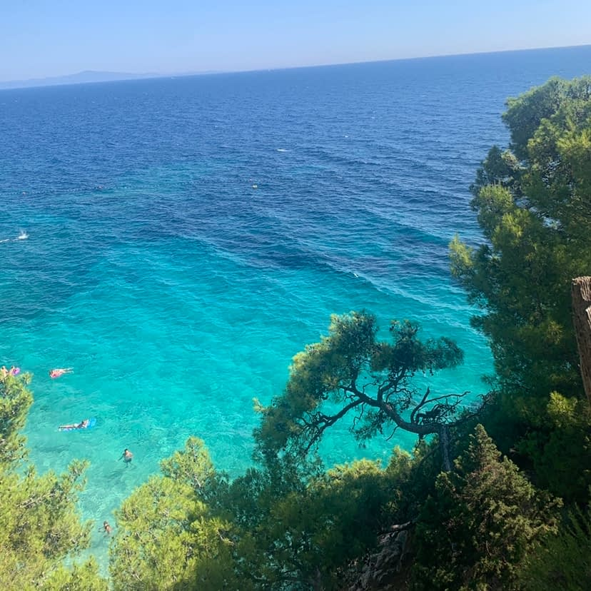 A view of turquoise water as part of the things to do in Hvar.
