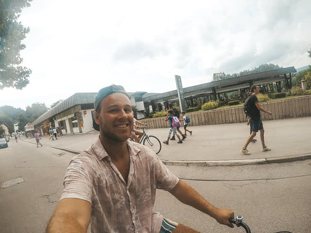A man taking a selfie whilst riding a bike. Things to do at Lake Bled