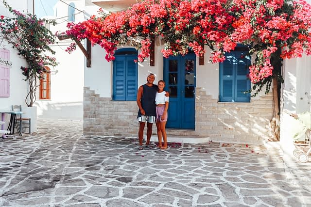 Colourful building in Paros with flowers blooming in Antiparos. Things to do in Antiparos
