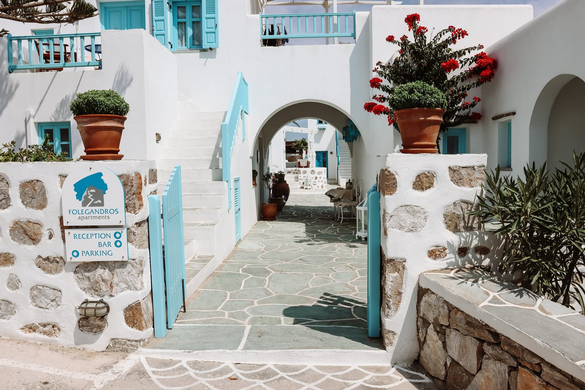Folegandros apartments. Whitewashed buildings with flowers. Where to stay in Folegandros