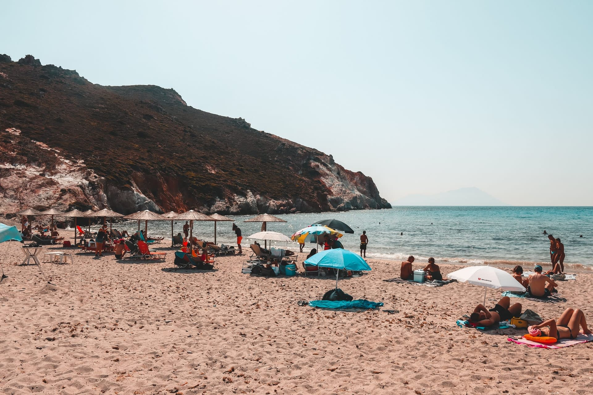 Plathiena beach with parasols. Things to do in Milos