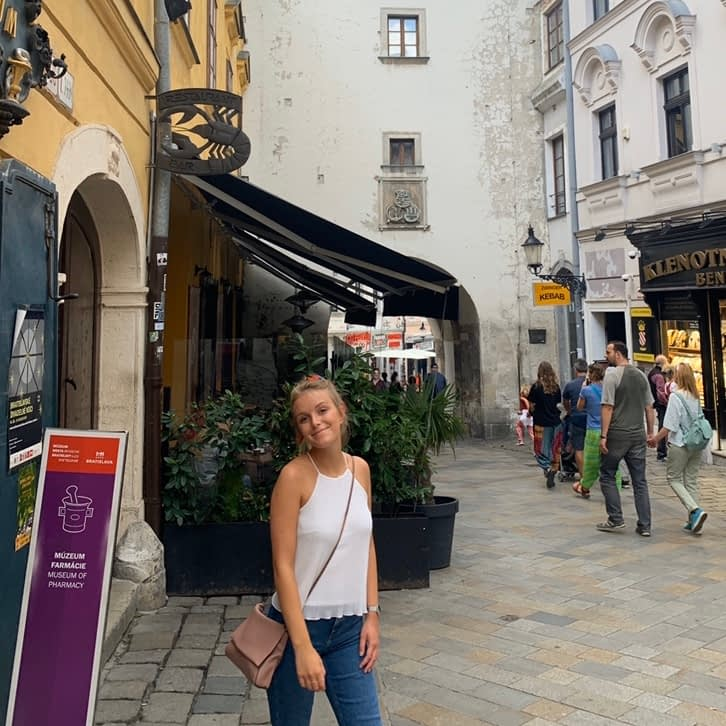 A woman stood in front of St. Michael's gate. Advised to visit from the Bratislava travel guide.