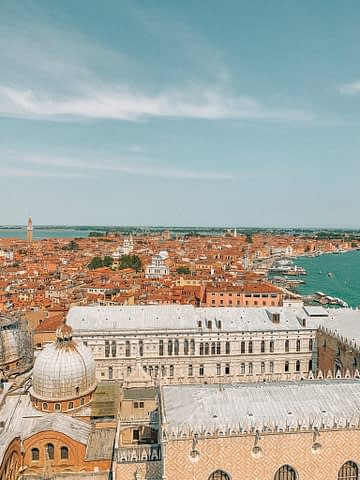 Campanile di San Marco Aerial view. Buildings and sea from above. A day in Venice