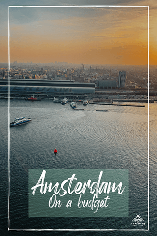 A view of Amsterdam and Boats in the sea during sunset.