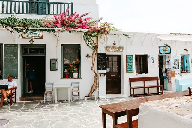 Folegandros Chora cafes with blossoming plants. What to do in Folegandros
