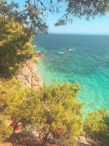 Jagodna Beach from an aerial view with green bushes nearby. Things to do in Hvar