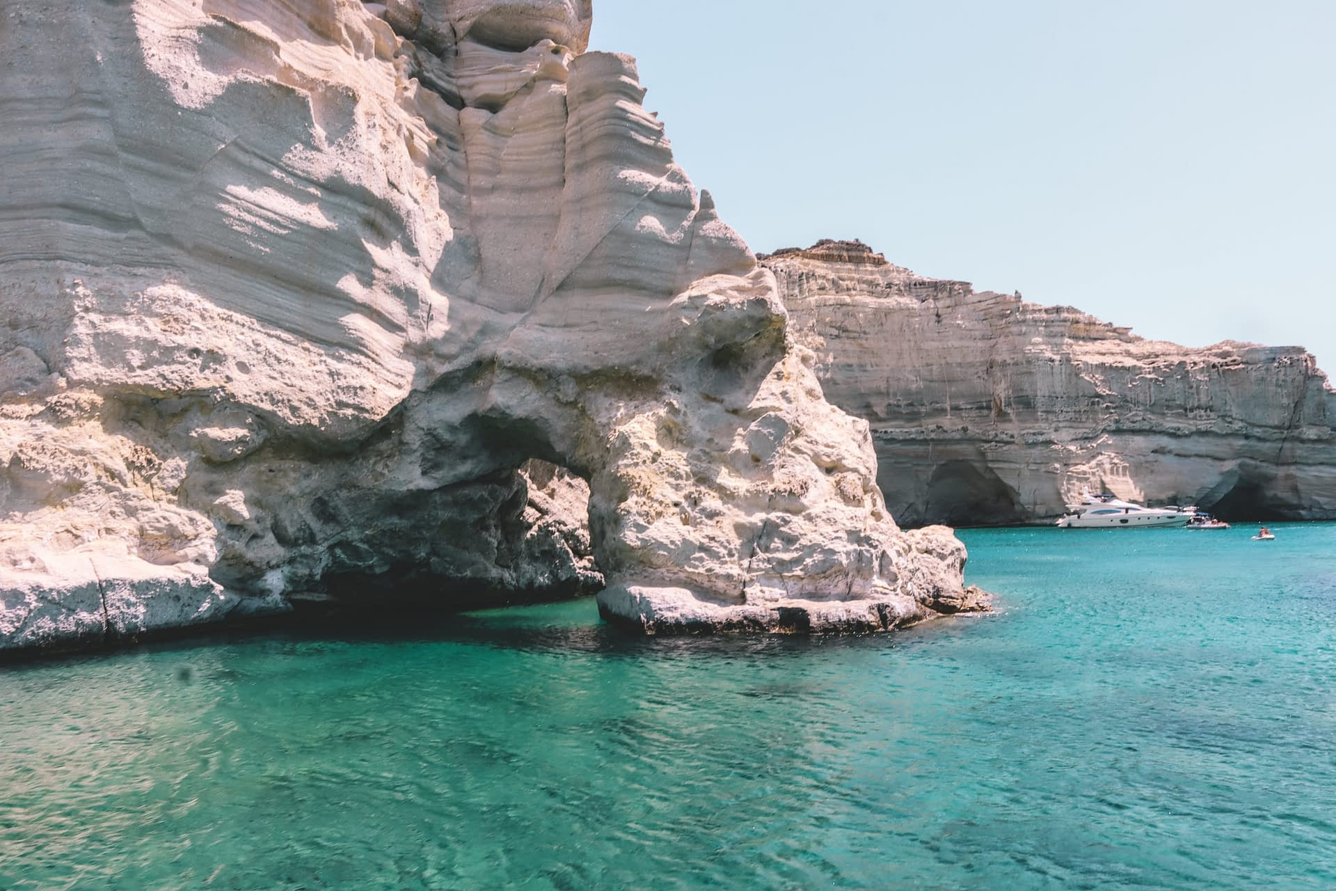 Kleftiko caves surrounded by clear water. What to do in Milos