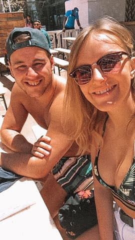 A couple at an outdoor party. What to do in Ibiza on a budget