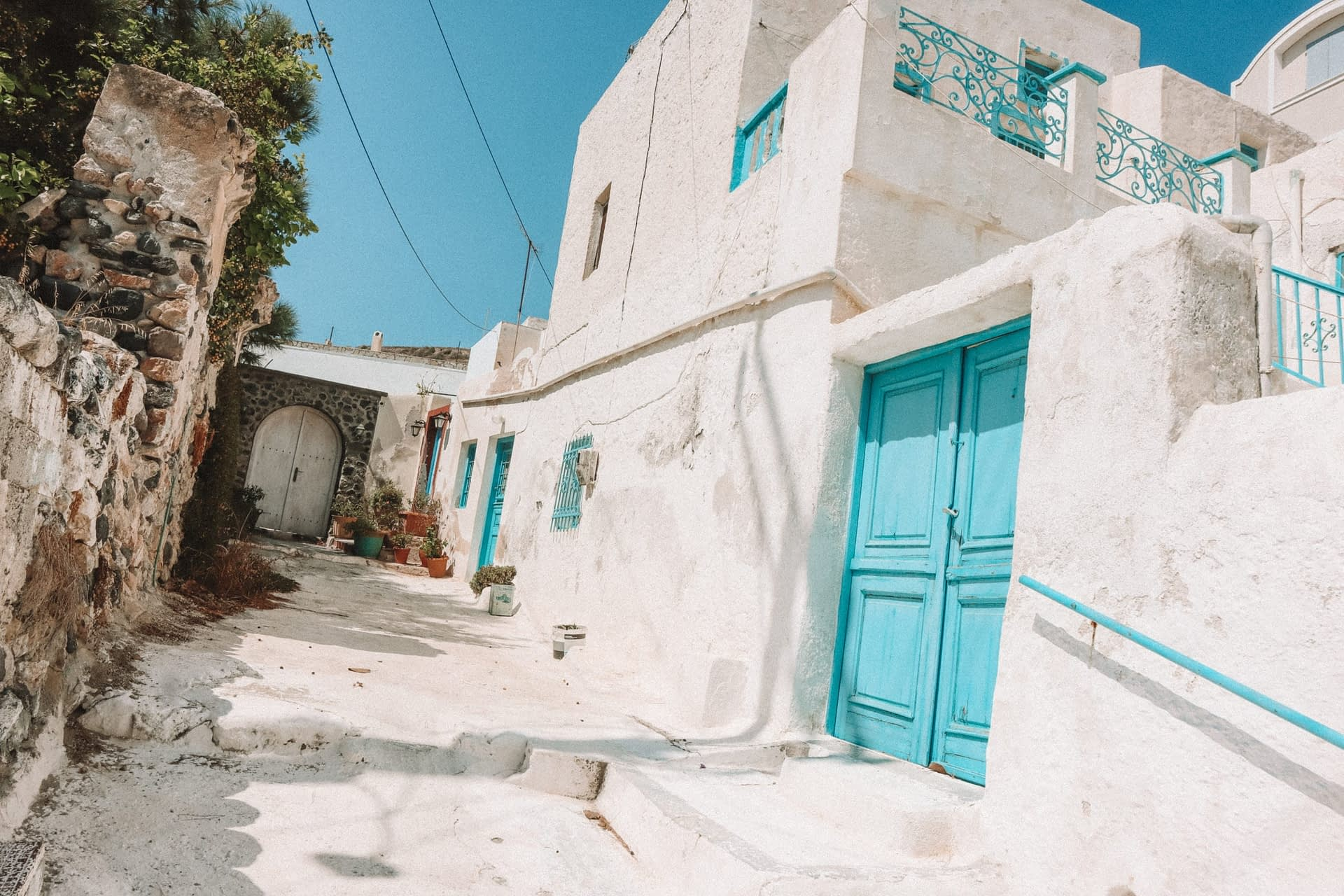 Light blue doots on whitewashed houses in Emporio village, Santorini