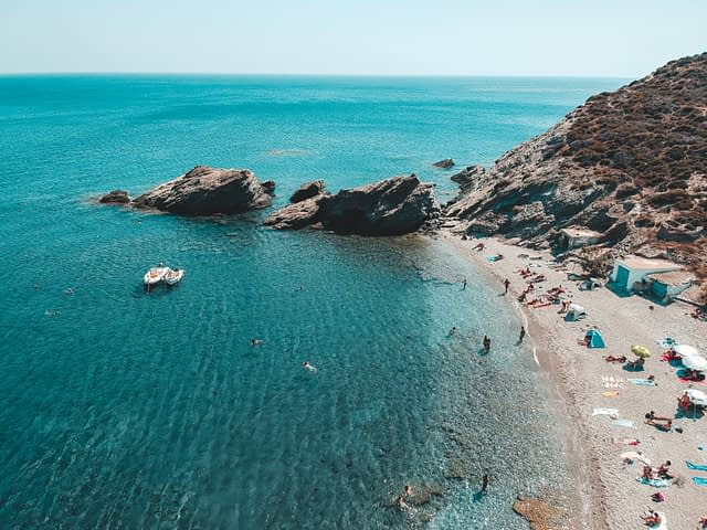 Agios Nikolaos. Best beaches in Folegandros. Turquoise ocean and boats from above