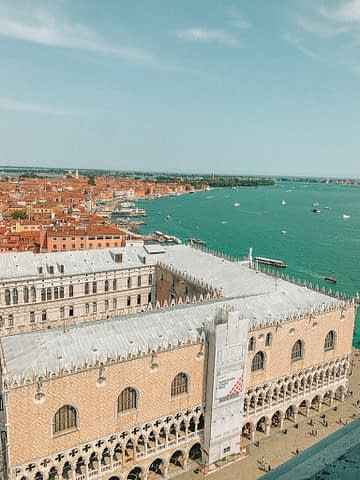 Aerial view of Venice with buildings and ocean in view. What to do in Venice