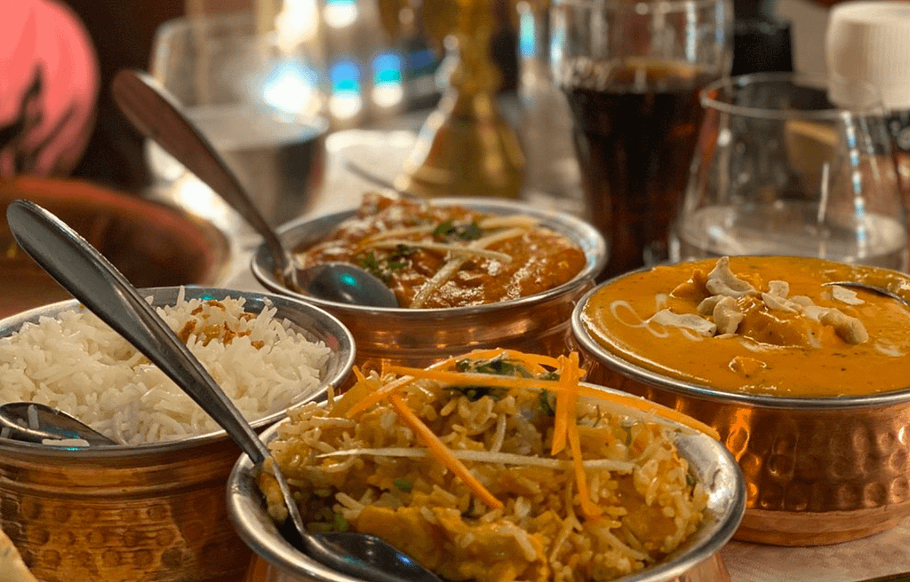 Indian curries in dishes.