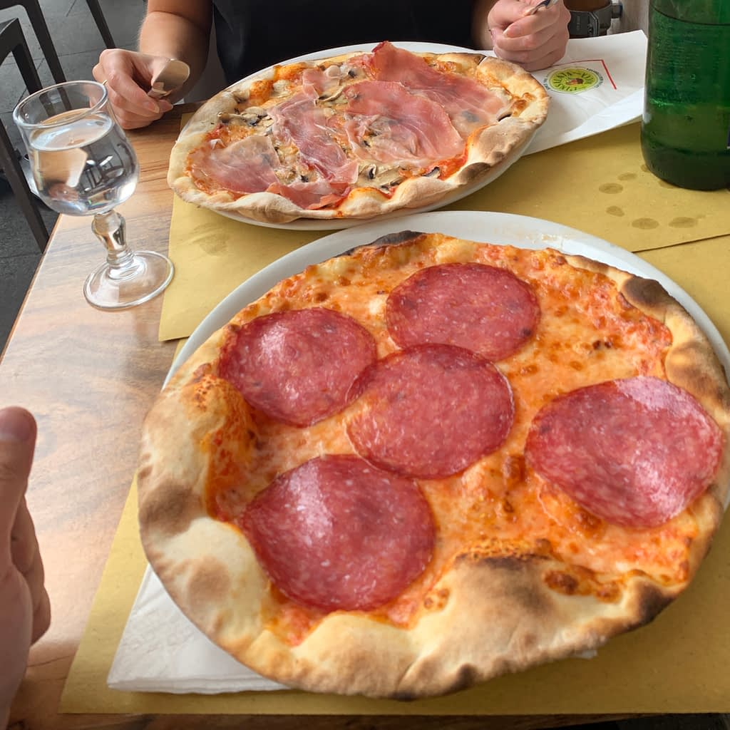 Pizzas with different ham toppings. Try any one with a 3 day itinerary in Rome.