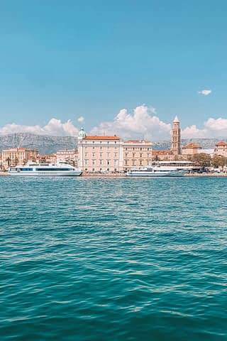 Ocean, buildings and boats in Split. How to get to Hvar