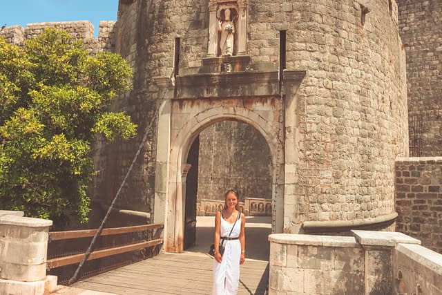 A woman stood in front of Ploče Gatent of