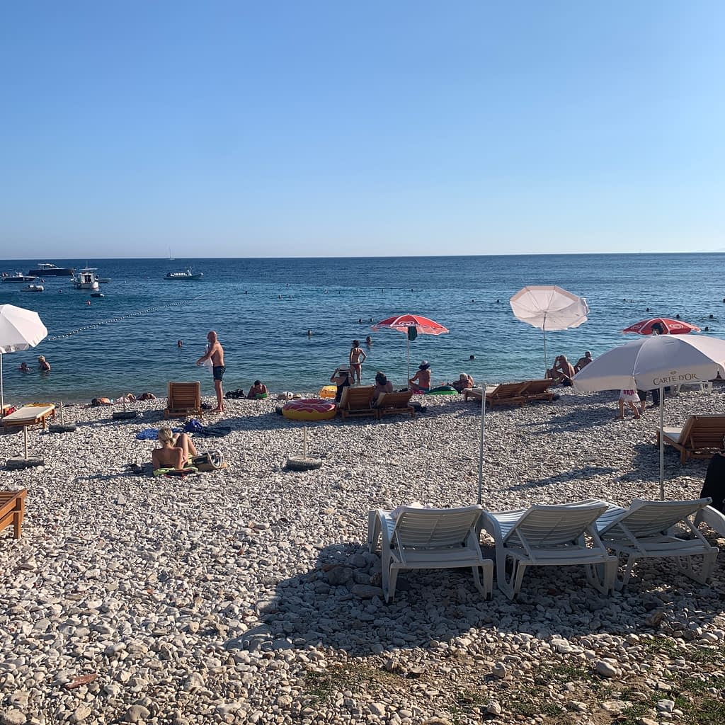 Milna beach with lots of pebbles as part of the things to do in Hvar.