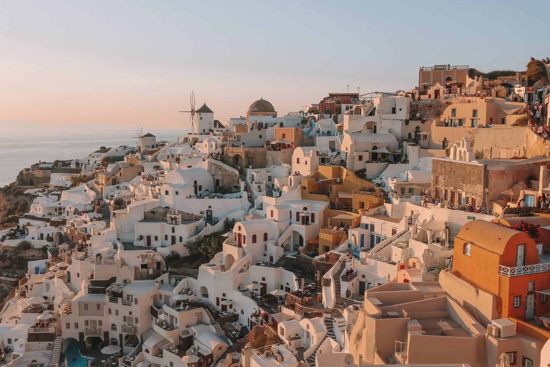 Oia buildings during sunset with a view from the Kastro