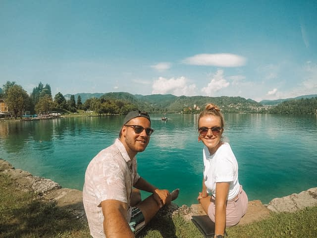 A couple taking a selfie at Lake Bled. What to do at Lake Bled