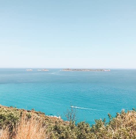 The sea, island and a boat in Sardinia. Things to do in Sardinia