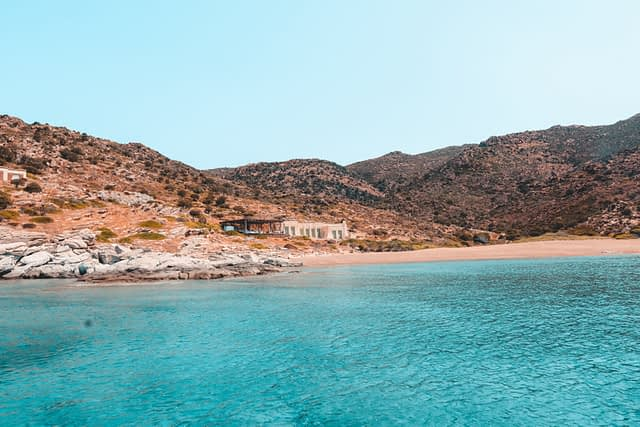 Pikri Nero beach with beach buildings in the beackground. Best beaches of Ios