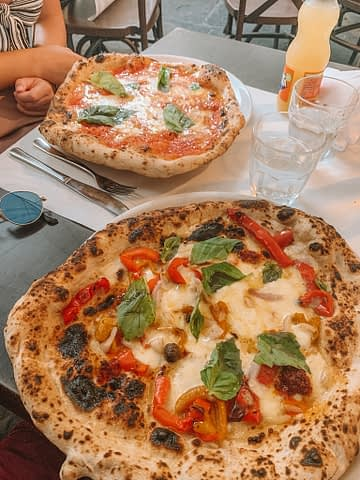 Cheese and tomato pizza. Things to do in Naples