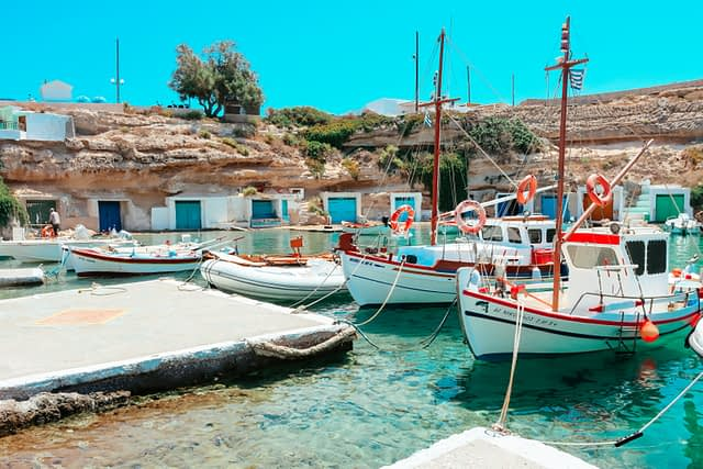 Boats and turquoise waters at a fishing village in Milos