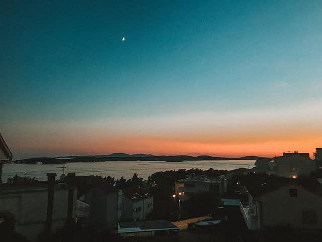 Dusk and sunset in Hvar. Orange skies and the moon. Where to go in Hvar