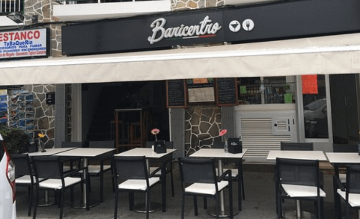A picture of a restaurant with tables outside as part of where to stay in Tenerife.
