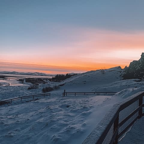 Thingvellir National Park with an orange sky from the sunset. Part of the golden circle tour in Iceland