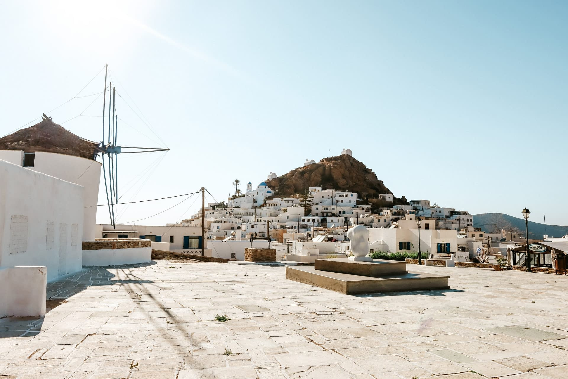 Windmills with Chora in the background. Ios travel blog
