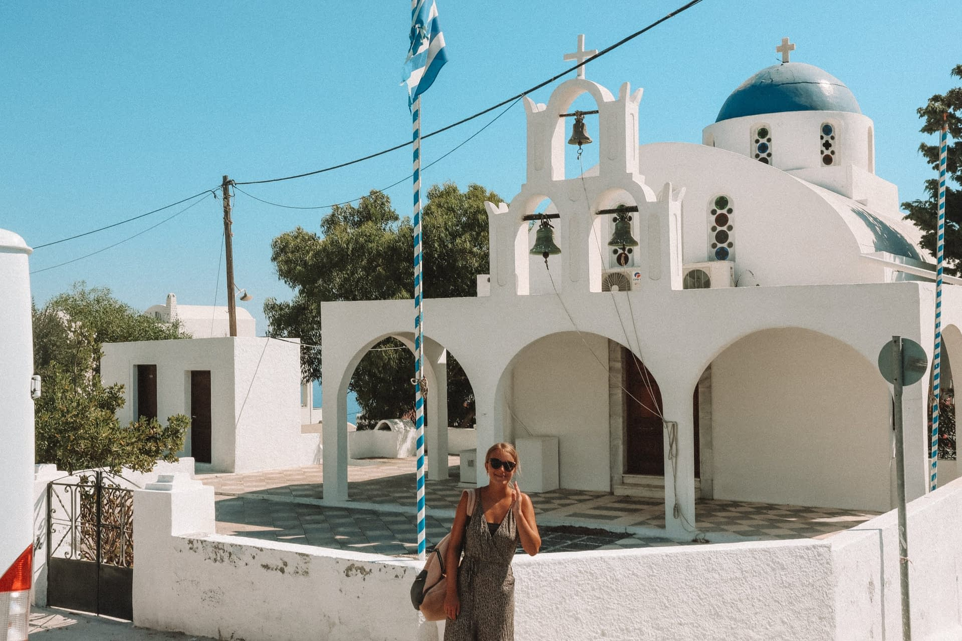 A woman stood in front of a church in Imerovigli