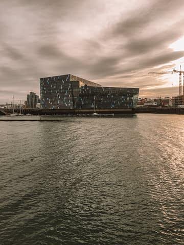 Harpa Concert Hall with the sea nearby in Reykjavik.