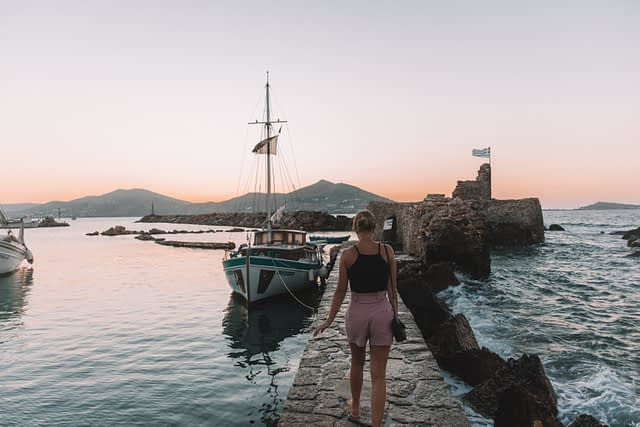 Naoussa castle and harbour at night. Things to do in Paros