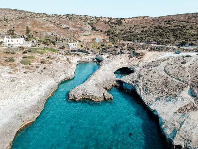 Kapos beach with turquoise water and cave structure. Best beaches in Milos