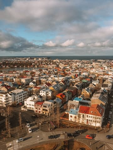 Hallgrimskirkja church with different coloured houses. Things to do in Iceland