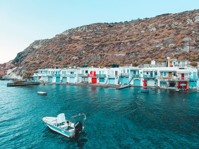 Klima village with nearby boats. Things to do in Milos
