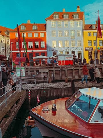 Colourful buildings and a boat in Nyhavn buildings. Part of 3 days in Copenhagen.