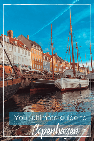 Colourful buildings and Sailing boats in the Nyhavn harbour, Copenhagen, Denmark.