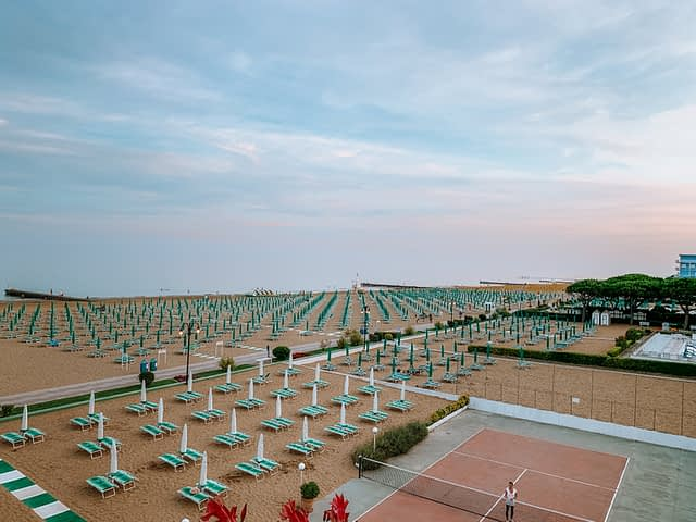 Lido di Jesolo beachfront with lots of sunbeds and umbrellas