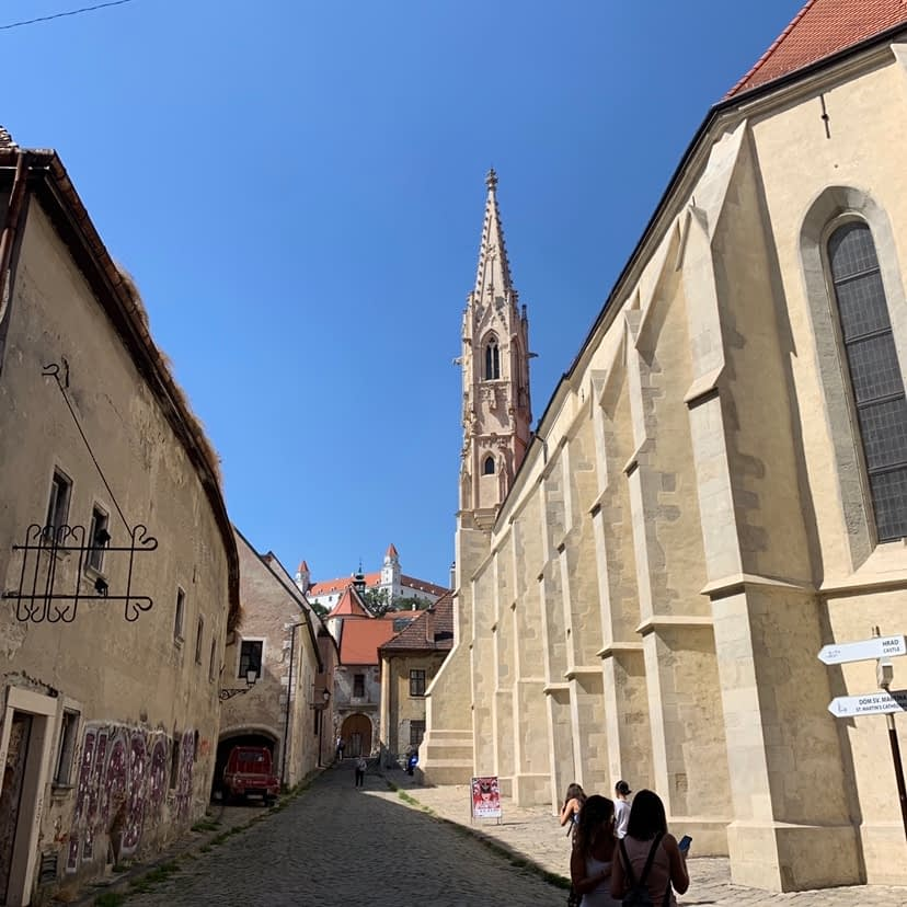 Kapitulska Street. An medieval cobbled road advised to visit in the Bratislava travel guide.
