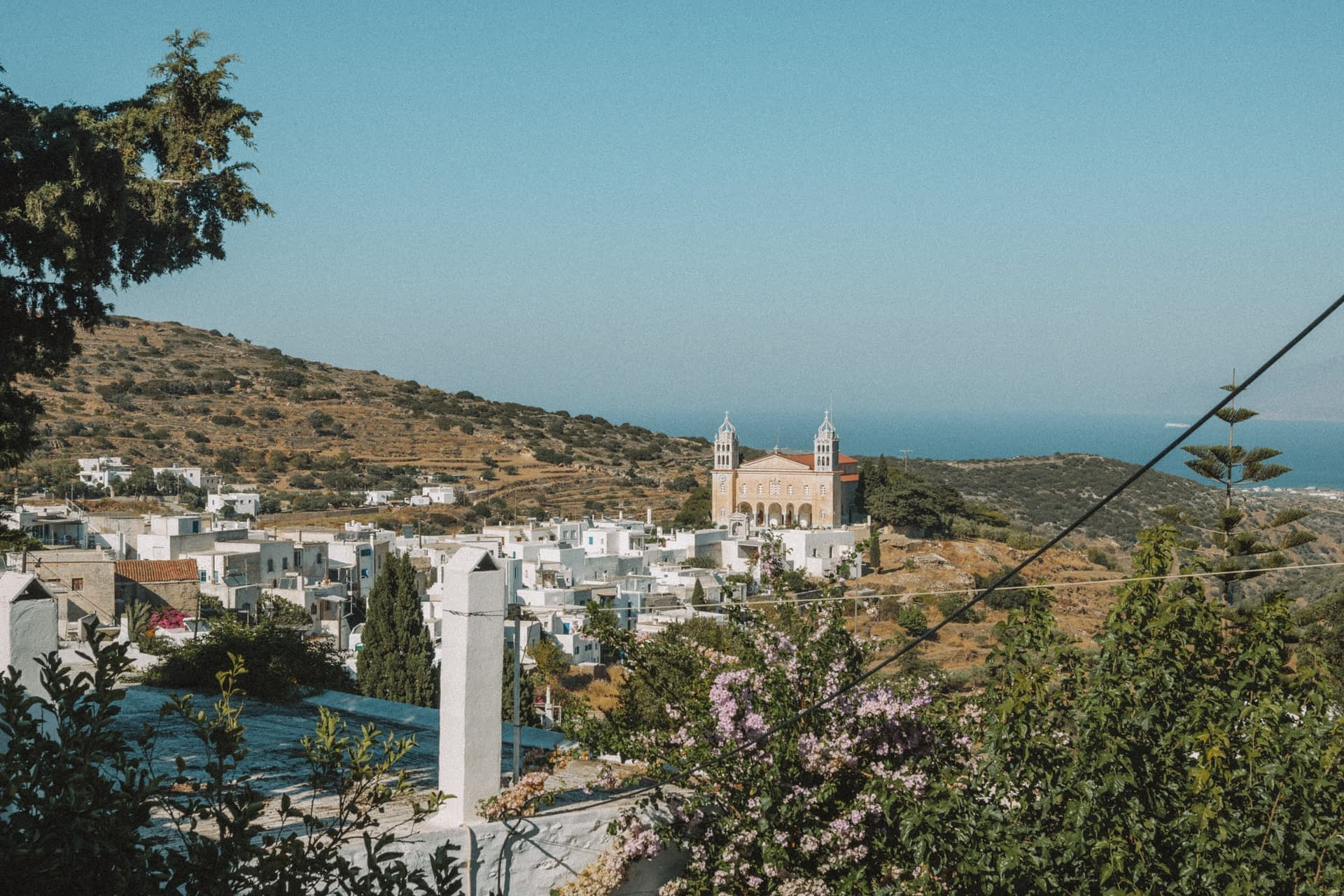 A far out view of Lefkes village with the sea in the background. Things to do in Paros