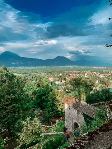 A view of mountains, houses and trees from Lake Bled castle. What to do at Lake Bled