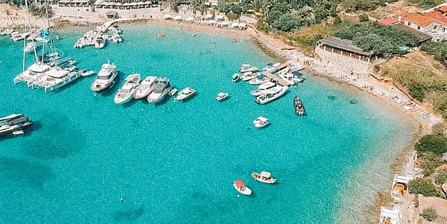 An aerial view of Palmižana with boats and turquoise sea. Things to do in the Pakleni islands near Hvar